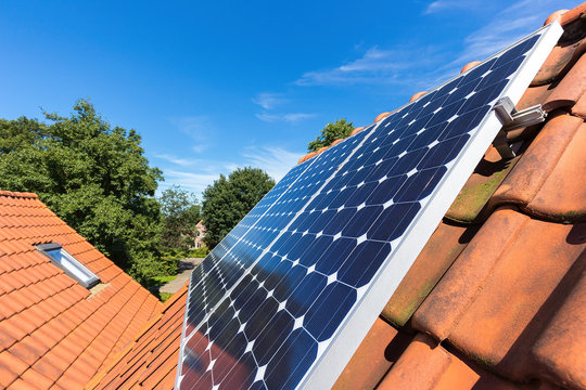 Row of solar panels  on roof at home
