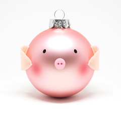 Christmas pink piggy ball for a tree on a white background