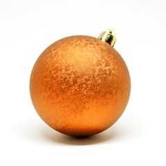 Single shiny orange decorative ball with ornaments for a Christmas tree isolated on a white background