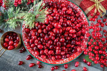 Fresh red cranberries in festive Christmas setting flat lay