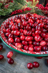 Fresh red cranberries in festive Christmas setting
