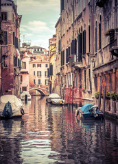 Fototapete - Narrow colorful street with parked boats, Venice, Italy