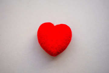 red heart on white background. soft focus.