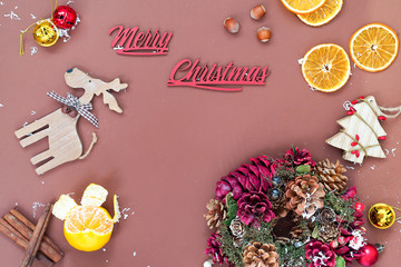 Christmas and New Year holidays background with Christmas wreaths, balls and toys , winter season. Christmas greeting card, copy space