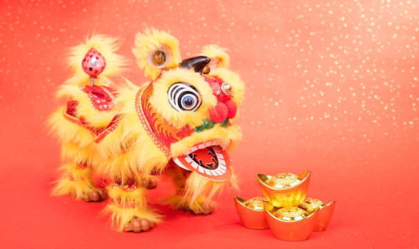 chinese traditional dancing lion with Gold ingot,