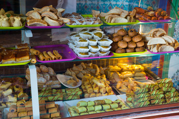Variety of oriental sweets on counter