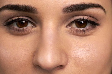 Close up female eyes with natural makeup. Human eyes emotions. Cosmetics and makeup.