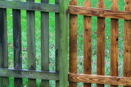 two parts of wooden fence before and after pressure wash