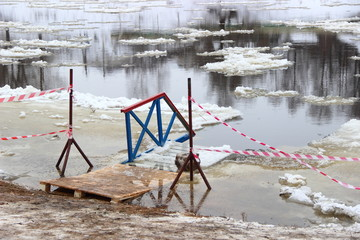 Healthy lifestyle, swimming in winter in ice hole - bridge in the water on the river