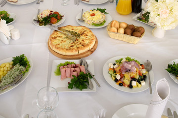 Cold dishes and snacks on the festive table. A rich luxurious meal in the restaurant.