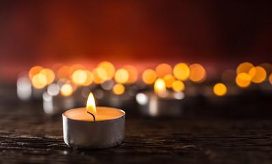 Many candles symolizing funeral religios christmas spa celebration birthday spirituality peace memorial or holiday burning at night