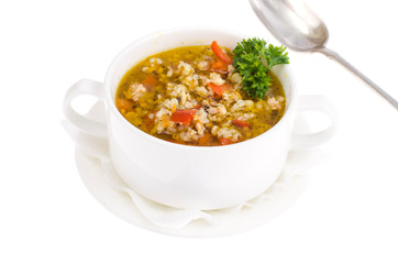 Bowl with rice soup and vegetables isolated on white background