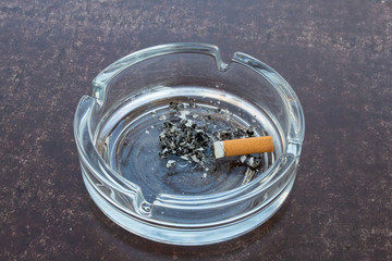 Ashtray with ashes and cigarette stub