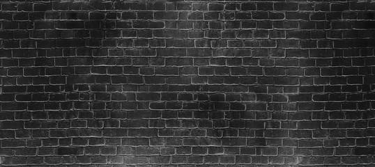Vintage old dark black wash brick wall texture. Panoramic background for your text or image.