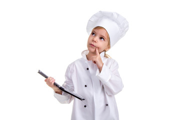 Girl chef white uniform isolated on white background. Holding the black ipad screen with one hand, and pointing finger on the cheek, thinking and looking up. Landscape image