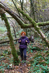 Hiker lady with backpack in the forest