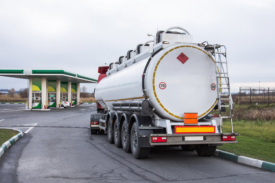 Truck with gasoline tank fuel before unloading at a gas station.
