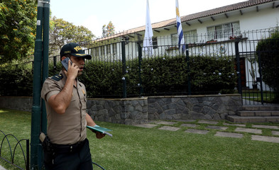 Police guard outside the residence of the Uruguayan ambassador in Peru, where former President Alan Garcia is seeking asylum, according to Peru's government, in Lima