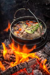 Hot and yummy hunter's stew with vegetables and herbs