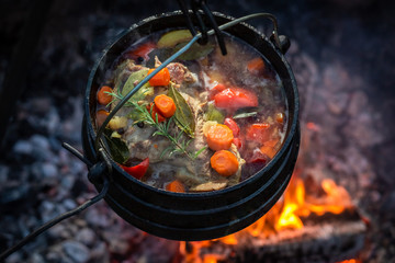 Tasty and homemade hunter's stew with vegetables and herbs