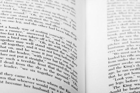 English words shown on two open book pages with selective depth of field.