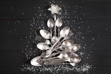 Christmas tree from Cutlery on dark background