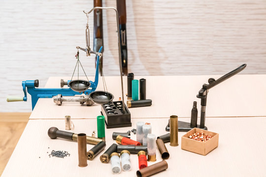 shotgun cartridges reloading. capsules, shells, powder, cartridges, scales on the table