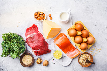 Balanced diet food background. Protein foods: fish, meat, eggs, cheese, quinoa, nuts on white background.