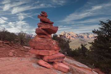 Sedona, Arizona hiking trail stones rocks balancing in harmony with tranquil landscape.