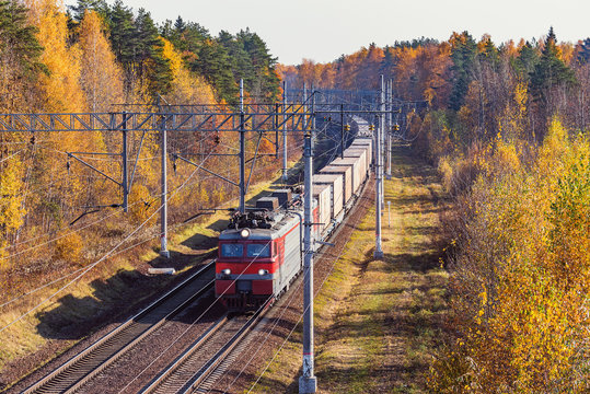Long freight train approaches to the station.