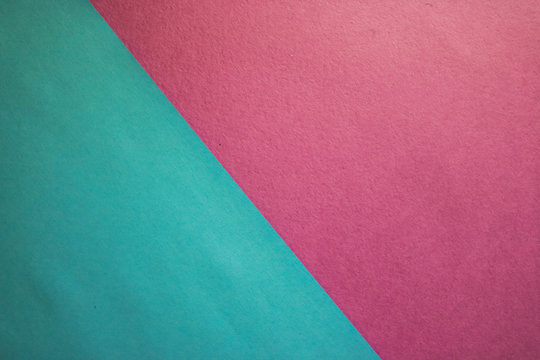 The texture of pink blue and purple colored paper beautiful modern delicate fabric fashionable glamorous divided into two parts. The background