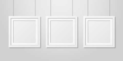 Three Vector Realistic Modern Interior White Blank Square Wooden Poster Picture Frame Set Hanging on the Ropes on White Wall Mock-up. Empty Poster Frames Design Template for Mockup, Presentation