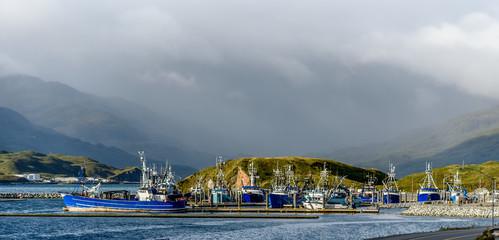 A Front Bow View of Alaskan Fishing Crab Boats at Port in Dutch Harbor Alaska