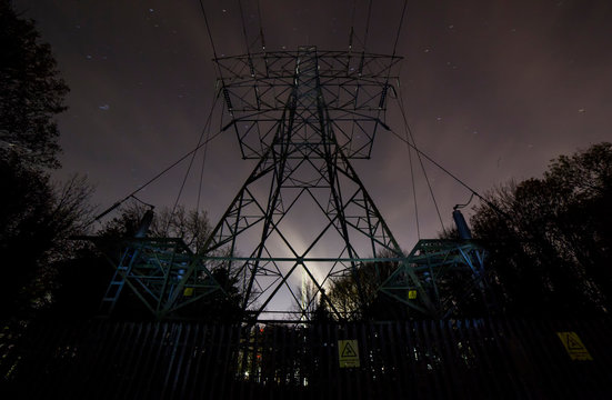 high voltage tower at night