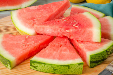 Slices of watermelon on a wood cutting board