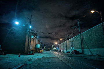 Wall Mural - Industrial urban street city night scene with vintage factory warehouses and train tracks
