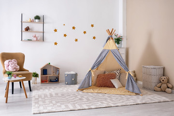 Cozy kids room interior with play tent and toys Wall mural