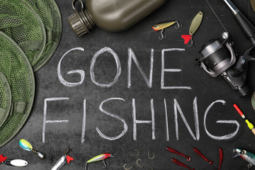 Flat lay composition with angling equipment and words