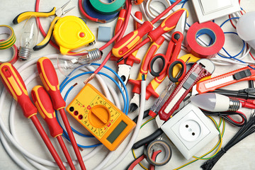 Set of electrician's tools on table, top view