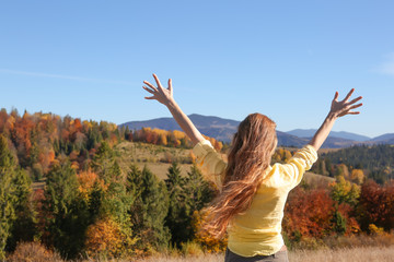 Female traveler feeling free in peaceful mountains