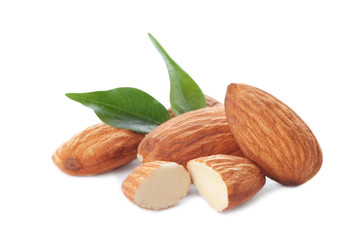 Organic almond nuts and leaves on white background. Healthy snack