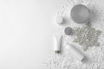 Set of cosmetic products on white background, flat lay with space for text. Winter care