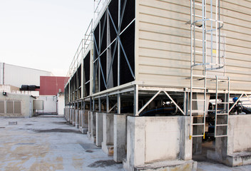 A set of cooling towers in a data center building is installed on the roof.