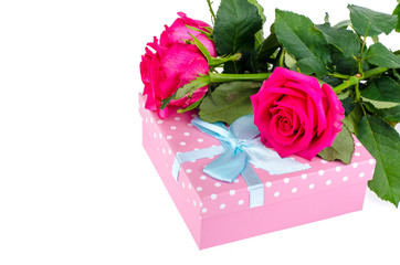 Beautiful bouquet of roses and gift box for holiday