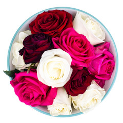 Heads of colored roses in bowl