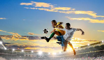 Soccer players at stadium. Mixed media