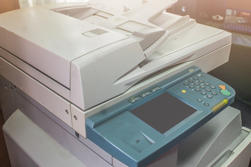 photocopier is a machine that makes paper copies
