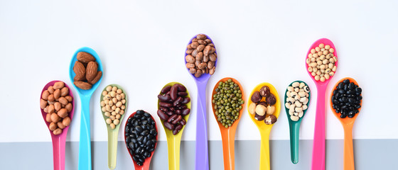 Assortment of beans and lentils on spoon for background