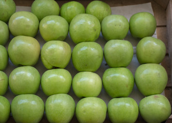 Green apples in a market place