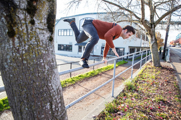 Parkour man jumping fence